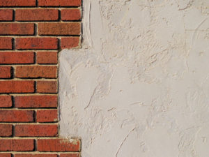 can you stucco over brick chimney